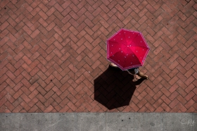 People here are afraid of the sun, so a sunny day is almost more colorful than a rainy one as the umbrellas come out.